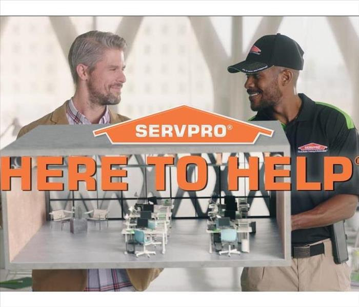 SERVPRO Employee with customer here to help